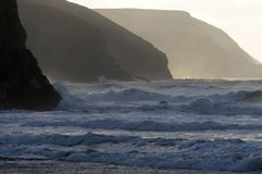 Atlantic waves and North Cornwall cliffs. The cliffs of the North Cornwall coast at Porthtowan on a stormy evening Stock Photography