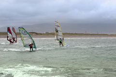 Atlantic wind surfers racing in the gale Stock Photos