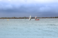 Atlantic wind surfers racing in the heavy storm Royalty Free Stock Photography