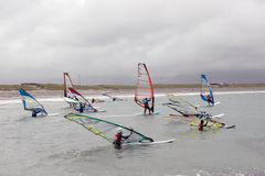 Atlantic wind surfers racing in the stormy winds Stock Photo