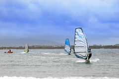 Atlantic wind surfers racing in the strong storms Stock Photo