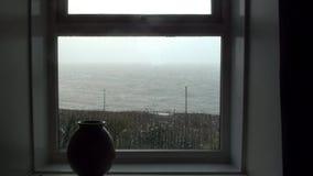 Atlantic through the window on an overcast rainy day stock video