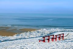 Atlantic winter view and red benches Royalty Free Stock Photography