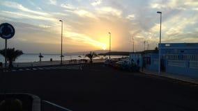 Atlantik de la playa de la puesta del sol Fotos de archivo