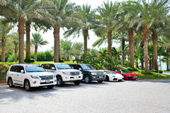 The Atlantis the Palm hotel and luxury off-road cars Royalty Free Stock Photos