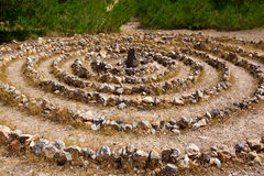 Atlantis spiral sign in Ibiza with stones on soil Stock Photography