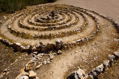 Atlantis spiral sign in Ibiza with stones on soil. At Balearic Islands Stock Image