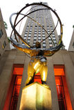Atlas. The GE Building rises behind the Atlas Statue at Rockefeller Center on 5th Avenue in New York City. Installed in 1937, the statue is in the art deco style