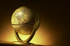 Atlas Globe. A vintage atlas globe shot with warm background stock image