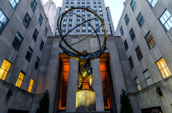 Atlas at Rockefeller Center. The Sculpture of Atlas as seen at the back of the GM Building at Rockefeller Center in Midtown Manhattannear the hour of dusk Royalty Free Stock Images