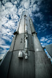 Atlas Rocket Looking Up. Looking up from the base of an historical, tall, steel Atlas Rocket reaching into a deep blue sky Royalty Free Stock Images