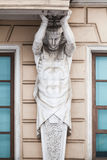 Atlas statue as decorative column of the facade. Atlas as decorative column of the facade of an old classical building in Saint-Petersburg, Russia Stock Photography