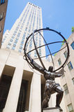 Atlas Statue in Rockefeller Center, New York. New York City, USA - August 2015: Low angle view of the Atlas Statue in front of Rockefeller Center in Manhattan Stock Image