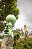 Atlas statue. Statue in the Welsh village of Portmeirion Stock Images
