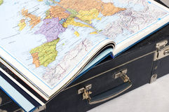 Atlas of the world on a suitcase Stock Images
