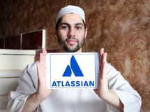 Atlassian Corporation logo. Logo of Atlassian Corporation on samsung tablet holded by arab muslim man. Atlassian Corporation is an enterprise software company Stock Images