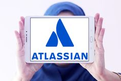 Atlassian Corporation logo. Logo of Atlassian Corporation on samsung tablet holded by arab muslim woman. Atlassian Corporation is an enterprise software company Royalty Free Stock Image