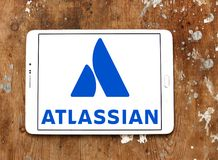 Atlassian Corporation logo. Logo of Atlassian Corporation on samsung tablet on wooden background. Atlassian Corporation is an enterprise software company that Stock Photo