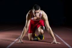 Atleet op het startblok royalty-vrije stock foto's