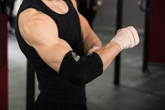 Atleet Person Wearing Bandage On Elbow royalty-vrije stock fotografie