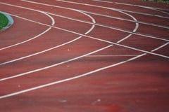 Atleet Track of Renbaanlijnen Atletiekspoor in stadion stock foto's
