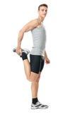 Atleta che fa gli esercizi di allungamenti Fotografia Stock Libera da Diritti