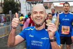Atleta com medalha Imagem de Stock Royalty Free