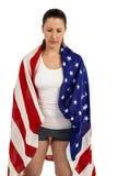 Atleta con la bandera americana envuelta alrededor de su cuerpo Imagenes de archivo