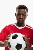 Atleta con un pallone da calcio Fotografia Stock Libera da Diritti