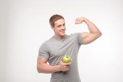 Atleta con una manzana fotografía de archivo