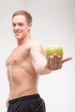 Atleta con una manzana foto de archivo libre de regalías