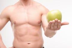 Atleta con una manzana imagen de archivo libre de regalías