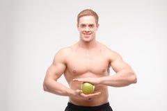 Atleta con una manzana foto de archivo