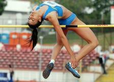 Atleta de la mujer del salto de altura imagen de archivo