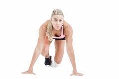 Atleta de sexo femenino en la línea del comienzo Foto de archivo
