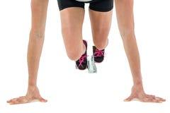 Atleta de sexo femenino en la posición lista para correr Imagen de archivo