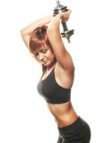 Atleta de sexo femenino joven que hace la extensión del tríceps del dos-brazo Imagenes de archivo