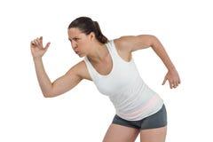Atleta de sexo femenino que corre en el fondo blanco Imágenes de archivo libres de regalías