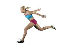 Atleta de sexo femenino que corre una carrera Imagen de archivo libre de regalías