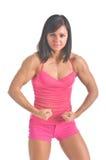 Atleta de sexo femenino que dobla sus músculos Imagenes de archivo