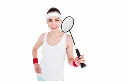 Atleta de sexo femenino que juega a bádminton Imagen de archivo