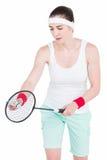 Atleta de sexo femenino que juega a bádminton Fotos de archivo