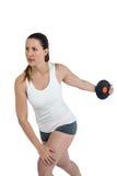 Atleta de sexo femenino que juega el tiro de disco en el fondo blanco Imagen de archivo libre de regalías