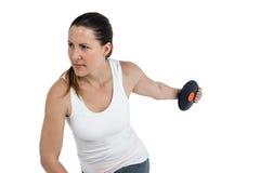 Atleta de sexo femenino que juega el tiro de disco en el fondo blanco Imágenes de archivo libres de regalías