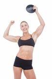 Atleta de sexo femenino que lleva a cabo el disco Imagen de archivo libre de regalías