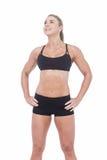 Atleta de sexo femenino que presenta con las manos en cadera Imagen de archivo libre de regalías
