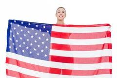 Atleta de sexo femenino que sostiene la bandera americana Imagen de archivo