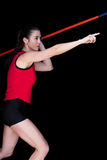 Atleta de sexo femenino Throwing una jabalina Fotos de archivo