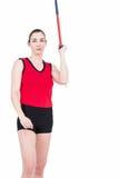 Atleta de sexo femenino Throwing una jabalina Imagen de archivo libre de regalías