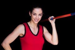 Atleta de sexo femenino Throwing una jabalina Imagenes de archivo